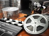 stock-photo-70210769-video-movie-cinema-vintage-concept-retro-camera-reels-and-cl